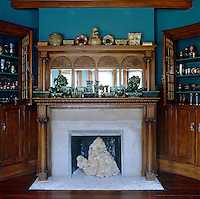 In the living room a large pyramid of fluorite is displayed in the Victorian fireplace