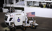 Washington, DC - January 20, 2009 -- United States President Barack Obama, first lady Michelle Obama and Vice President Joseph Biden watch as the National Aeronautics and Space Administration (NASA) Lunar Electric Rover stops in front of the Presidential reviewing stand on Pennsylvania Avenue in front of the White House in Washington, Tuesday, January 20, 2009. .Mandatory Credit: Bill Ingalls - NASA via CNP