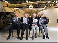 BNPS.co.uk (01202 558833)<br /> Pic: PhilYeomans/BNPS<br /> <br /> (L to R) Waldemar Pliska, Ernest Slarks, Wilhelm Fischer and Ken Tout hold old photos of themselves in uniform.<br /> <br /> This is the poignant moment two German Tiger tank drivers and their British counterparts met for the first time 72 years after they fought on opposite sides in the Second World War.<br /> <br /> Wilhelm Fischer and Waldemar Pliska helped instill terror in British troops by manning the fearsome fighting machines and unleashing hell with their huge 88mm guns.<br /> <br /> Two of the enemy with first hand experiences of the heavily armoured Tigers were British tank men Ernest Slarks and Dr Ken Tout.<br /> <br /> Now aged in their 90s the four old foes became friends when they assembled for the launch of an historic exhibition at the Tank Museum in Bovington, Dorset.