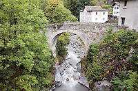 ARCH<br /> Bridge With A Roman Arch<br /> Promontogno, Switzerland<br />  The Roman arch contains voussoirs, or bricks. The keystone is the center voussoir that supports the other bricks. The push or thrust of the cemented voussoirs push outward and downward in the arch.