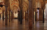 Hypostyle prayer hall, area built under Prince Abd Al-Rahman II, begun 832, in the Cathedral-Great Mosque of Cordoba, in Cordoba, Andalusia, Southern Spain. The hall is filled with rows of columns topped with double arches in stripes of red brick and white stone. The first church built here by the Visigoths in the 7th century was split in half by the Moors, becoming half church, half mosque. In 784, the Great Mosque of Cordoba was begun in its place and developed over 200 years, but in 1236 it was converted into a catholic church, with a Renaissance cathedral nave built in the 16th century. The historic centre of Cordoba is listed as a UNESCO World Heritage Site. Picture by Manuel Cohen