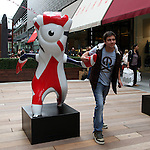 Tourists enjoying a picture with London Olympic Games mascots, Wenlock and Mandeville, Westfield Stratford, July 2012