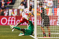 Thierry Henry (14) of the New York Red Bulls attempts to score on D. C. Unitedgoalkeeper Bill Hamid (28). The New York Red Bulls and D. C. United played to a 0-0 tie during a Major League Soccer (MLS) match at Red Bull Arena in Harrison, NJ, on March 16, 2013.
