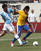 Brazil forward Neymar (11) drives for the net as Argentina defender Ezequiel Garay (2) defends. In an international friendly (Clash of Titans), Argentina defeated Brazil, 4-3, at MetLife Stadium on June 9, 2012.