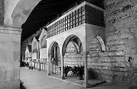 Low angle view of tombs in the Romanesque cloister of the Basilica di San Zeno, 10th-14th centuries, Verona, Italy. This Romanesque church which forms the pattern for Verona's Romanesque style was constructed in 967 but damaged by an earthquake in 1117 and restored and enlarged from 1138 to 1398. Picture by Manuel Cohen.