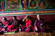 Buddhist nuns take a break after meditation inside the Ramtanka Temple in Paro, Bhutan. Photo: Sanjit Das/Panos