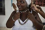 RIO DE JANEIRO, BRAZIL - JANUARY 24: Alana Moreira, 13, prepares for a candomble ceremony, in Rio de Janeiro, Brazil, on Saturday, Jan. 23, 2015. Brazil's Afro-Brazilian religions which in recent years have come under increasing threats and prejudice, particularly from the growing number of evangelical churches. Candombl&eacute; originated in Salvador, Bahia at the beginning of the 19th century when enslaved Africans brought their beliefs with them. Umbanda and candombl&eacute; are Afro-Brazilian religions practiced in mostly Brazil. <br /> (Lianne Milton for the Washington Post)