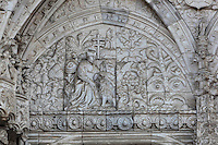 Relief of St Jerome pulling the thorn from the lion's paw, on the tympanum of the South Portal, 1516-18, by Joao de Castilho, 1470ñ1552, after a design by Diogo de Boitaca, Church of Santa Maria, at the Jeronimos Monastery or Hieronymites Monastery, a monastery of the Order of St Jerome, built in the 16th century in Late Gothic Manueline style, Belem, Lisbon, Portugal. The portal consists of double doors with a tympanum carved with scenes from the life of St Jerome, a statue of Henry the Navigator, many carved statues in niches, a statue of the Madonna and many flamboyant pinnacles and gables in Manueline style. The monastery is listed as a UNESCO World Heritage Site. Picture by Manuel Cohen