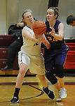 Ketchikan's Hannah Maxwell knocks the ball away from Lathrop's Aislynn Odsather in their Dimond Lady Lynx Prep Shootout basketball game Friday, February 10, 2017.  Photo for the Daily News by Michael Dinneen