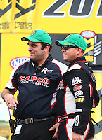 May 1, 2016; Baytown, TX, USA; NHRA top fuel driver Steve Torrence (right) with crew member Bob Lagana during the Spring Nationals at Royal Purple Raceway. Mandatory Credit: Mark J. Rebilas-USA TODAY Sports
