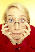 Stock photo of a surprised blond woman with a shocked expression.