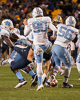 Pitt linebacker Quintin Wirginis (58) blocks a punt by North Carolina punter Corbin Daly (90).The North Carolina Tar Heels football team defeated the Pitt Panthers 26-19 on Thursday, October 29, 2015 at Heinz Field, Pittsburgh, Pennsylvania.