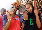 High school students during a photo workshop in Likoni, Kenya.   The workshop was organized by the Hatua Likoni Foundation's founder Gabrielle Fondiller and New York photographer Todd Shapera with cameras from U.S. donors.   The students receive financial scholarships from the Hatua Likoni Foundation to enable them to attend a quality, private high school in Likoni - Moi Forces.  The workshop took place on two Sunday afternoons in February for 32 students, and is part of a Sunday mentoring program offered by Hatua Likoni to the Foundation's scholarship students.
