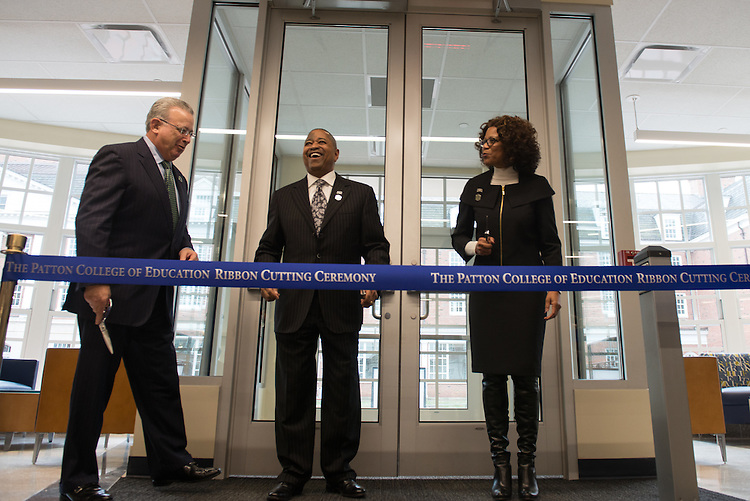 President Roderick McDavis, center, Chair of the Board of Trustees David A. Wolfort, left, and Dean Renee Middleton right, prepare for the ribbon cutting for the Gladys W. and David H. Patton College of Education's newly renovated McCracken Hall held on January 27, 2017.