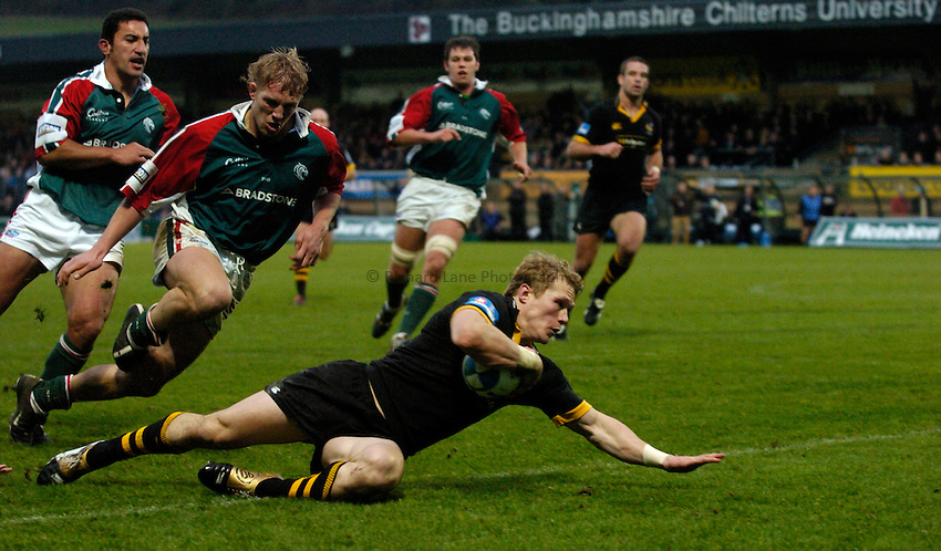 Photo: Richard Lane..London Wasps v Leicester Tigers. Heineken Cup. 05/12/2004..Josh Lewsey breaks past Daryl Gibson and Lewis Moody for a try.