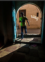 TRIPOLI, LIBYA &mdash; <br /> <br /> A man walks through the door of the souk in Tripoli's old city. Life in Tripoli goes on as normal as possible. After sunset, gun fire from local criminal groups can be heard as a state of lawlessness takes over the relative calm that is daylight hours.