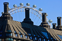 British Airways London Eye seen above rooftops, England, United Kingdom