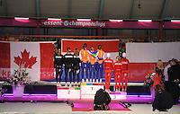 SCHAATSEN: HEERENVEEN: Thialf, Essent ISU World Single Distances Championships 2012, 25-03-2012, Podium Team Pursuit Ladies, Team Canada (Brittany Schussler, Christine Nesbitt, Cindy Klassen), Team Netherlands (Ireen Wüst, Diane Valkenburg, Linda de Vries), Team Poland (Natalia Czerwonka, Katarzyna Wozniak, Luiza Zlotkowska), ©foto Martin de Jong