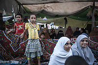 In this Wednesday, Jul. 10, 2013 photo, female supporters of the ousted president Mohammed Morsi are seen as they observe fasting in the streets nearby Al-Rabba Alawya mosque during the first day of the holy month of Ramadan in Cairo, Egypt. (Photo/Narciso Contreras).
