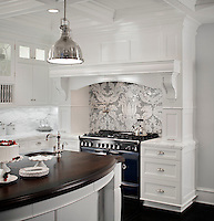 This custom kitchen features a handmade Kingston Lacy backsplash, shown in Calacatta Tia and Bardiglio is by Rogers &amp; Goffigon for New Ravenna.<br />