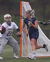 University of New Hampshire midfielder Ilana Cohen (9) works behind the net. Boston College defeated University of New Hampshire, 11-6, at Newton Campus Field, May 1, 2012.