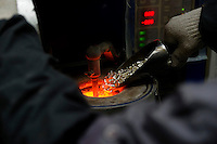 Melting of silver in jewelry factory, Panyu, Guangzhou Province, China