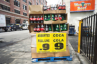 A display promoting discounts on Coca-Cola brands outside a Western Beef supermarket in the New York neighborhood of Chelsea on Thursday, July 27, 2012.  (© Richard B. Levine)