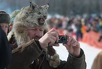 Doug Perfetto of Anchorage takes photos of musher Ken Anderson during the 2013 Iditarod restart on Willow Lake on Sunday, March 3. (Stephen Nowers photo)