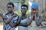Girls watch a game led by Catholic pastoral workers in the Makpandu refugee camp in Southern Sudan, 44 km north of Yambio, where more that 4,000 people took refuge in late 2008 when the Lord's Resistance Army attacked their communities inside the Democratic Republic of the Congo. Attacks by the LRA inside Southern Sudan and in the neighboring DRC and Central African Republic have displaced tens of thousands of people, and many worry the attacks will increase as the government in Khartoum uses the LRA to destabilize Southern Sudan, where people are scheduled to vote on independence in January 2011. Catholic pastoral workers have accompanied the people of this camp from the beginning.
