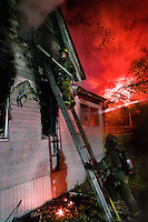 "Firefighters battle a blaze at a house in Detroit, Michigan. During the days surrounding Halloween of 2008 there were around 100 arson attacks in the city. This is much higher than the yearly average, but nothing like the infamous ""Devil Nights"" of the 1980s. In 1984, nearly 800 fires were started in the three days around Halloween."