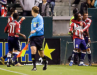 Chivas USA players Chukwudi Chijindu (77) is congratulated by teammate Ben Zemanski (21) after scoring his goal. CD Chivas USA defeated the San Jose Earthquakes 3-2 at Home Depot Center stadium in Carson, California on Saturday April 24, 2010.  .