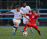 Marc Pelosi (11) of the United States fights for the ball with Bryan Santamaria (17) of Panama during the group stage of the CONCACAF Men's Under 17 Championship at Jarrett Park in Montego Bay, Jamaica. The USA defeated Panama, 1-0.