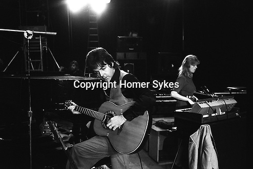 "Paul and Linda McCartney Wings Tour 1975. Sound check at the Elstree rehearsal studio London England.. The photographs from this set were taken in 1975. I was on tour with them for a children's ""Fact Book"". This book was called, The Facts about a Pop Group Featuring Wings. Introduced by Paul McCartney, published by G.Whizzard. They had recently recorded albums, Wildlife, Red Rose Speedway, Band on the Run and Venus and Mars. I believe it was the English leg of Wings Over the World tour. But as I recall they were promoting,  Band on the Run and Venus and Mars in particular."