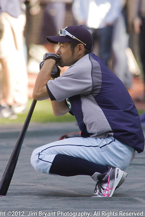 Seattle Mariners right fielder Ichiro Suzuki, of Japan, waits to take batting practice before  Mariner's s opening home game of the season with the Oakland Athletics at SAFECO Field in Seattle April 13, 2012.  &copy; 2012. Jim Bryant Photo. All Rights Reserved.