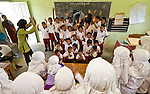 Kids go crazy during a school visit from Icut and her Sumatran elephant mascot