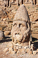 Pictures of the statues of around the tomb of Commagene King Antochus 1 on the top of Mount Nemrut, Turkey. Stock photos & Photo art prints. In 62 BC, King Antiochus I Theos of Commagene built on the mountain top a tomb-sanctuary flanked by huge statues (8–9 m/26–30 ft high) of himself, two lions, two eagles and various Greek, Armenian, and Iranian gods. The photos show the broken statues on the  2,134 m (7,001 ft)  mountain. 3