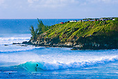 A surfer tube rides in Honolua Bay on Maui's North Shore.