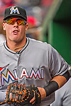 7 April 2016: Miami Marlins first baseman Justin Bour stands ready in the dugout prior to the Washington Nationals Home Opening Game at Nationals Park in Washington, DC. The Marlins defeated the Nationals 6-4 in their first meeting of the 2016 MLB season. Mandatory Credit: Ed Wolfstein Photo *** RAW (NEF) Image File Available ***