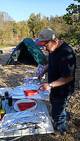 NWA Democrat-Gazette/FLIP PUTTHOFF <br /> Hog Ears gets salmon ready for the grill Oct. 17, 2015. He caught the fish from the Kenai River in Alaska, where he lives.