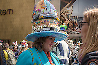 A woman displays her hat's decoration while people attend the annual easter parade in Manhattan, New York, 03.27.2016. This annual tradition has been taking place in New York City for over 100 years, Photo by VIEWpress/Maite H. Mateo.