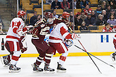 Garrett Noonan (BU - 13), Brendan Silk (BC - 9), T.J. Ryan (BU - 3) - The Boston College Eagles defeated the Boston University Terriers 3-1 (EN) in their opening round game of the 2014 Beanpot on Monday, February 3, 2014, at TD Garden in Boston, Massachusetts.