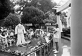 Memphis, Tennessee<br /> USA<br /> August 14, 2002<br /> <br /> A young girl clings to her teddy bear at the grave of Elvis Presley in Graceland during &quot;Elvis Week&quot; marking the 25th anniversary of the King's death.
