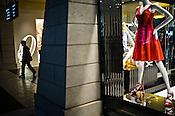 A Chinese man walks past a shop at The Venetian Macau Resort Hotel in Macau, China.