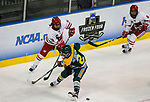 ST CHARLES, MO - MARCH 19:  Abby Roque (18) of the Wisconsin Badgers centers the puck past Corie Jacobson (2) of the Clarkson Golden Knights during the Division I Women's Ice Hockey Championship held at The Family Arena on March 19, 2017 in St Charles, Missouri. Clarkson defeated Wisconsin 3-0 to win the national championship. (Photo by Mark Buckner/NCAA Photos via Getty Images)