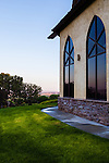 The pastel colors of dawn reflect in the window of a building at the St. Chapelle Winery in Caldwell Idaho.