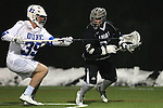 01 March 2015: Providence's Conner Byrne (right) and Duke's Ian Yanulis (39). The Duke University Blue Devils hosted the Providence College Friars on the West Turf Field at the Duke Athletic Field Complex in Durham, North Carolina in a 2015 NCAA Division I Men's Lacrosse match. Duke won the game 20-8.