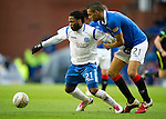 Rangers v St Johnstone....27.02.11 .Collin Samuel fends off Kyle Bartley.Picture by Graeme Hart..Copyright Perthshire Picture Agency.Tel: 01738 623350  Mobile: 07990 594431