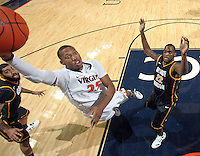 CHARLOTTESVILLE, VA- DECEMBER 6: Akil Mitchell #25 of the Virginia Cavaliers shoots between Ryan Pearson #24 of the George Mason Patriots and Mike Morrison #22 of the George Mason Patriots  during the game on December 6, 2011 at the John Paul Jones Arena in Charlottesville, Virginia. Virginia defeated George Mason 68-48. (Photo by Andrew Shurtleff/Getty Images) *** Local Caption *** Akil Mitchell;Ryan Pearson;Mike Morrison