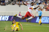 Jeremy Hall (17) of the New York Red Bulls flies over a tackle by Frankie Hejduk (2) of the Columbus Crew. The Columbus Crew defeated the New York Red Bulls 3-1 during a Major League Soccer (MLS) match at Red Bull Arena in Harrison, NJ, on May 20, 2010.