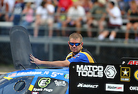 Jul 23, 2016; Morrison, CO, USA; Crew member for NHRA funny car driver Matt Hagan during qualifying for the Mile High Nationals at Bandimere Speedway. Mandatory Credit: Mark J. Rebilas-USA TODAY Sports